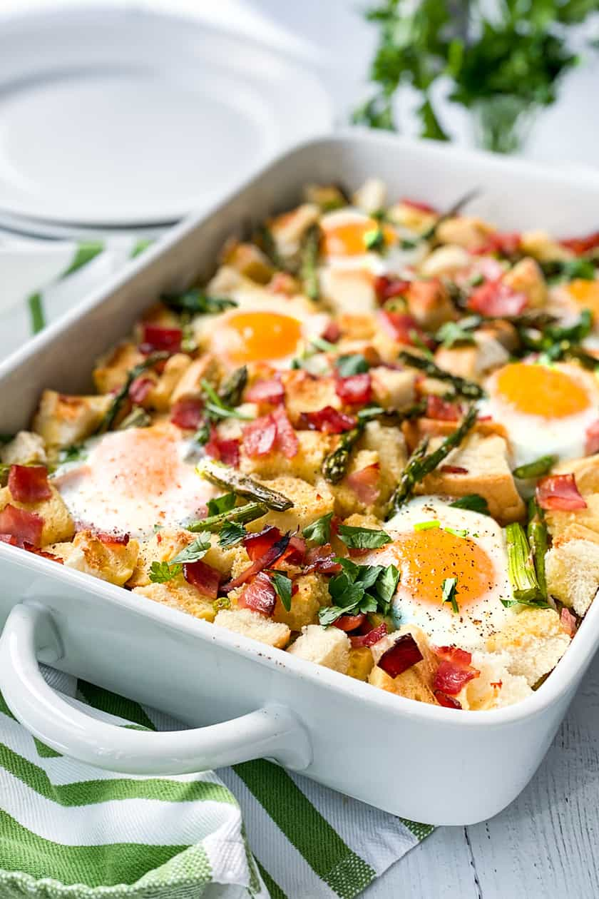 Side view of baked strata with ham and asparagus