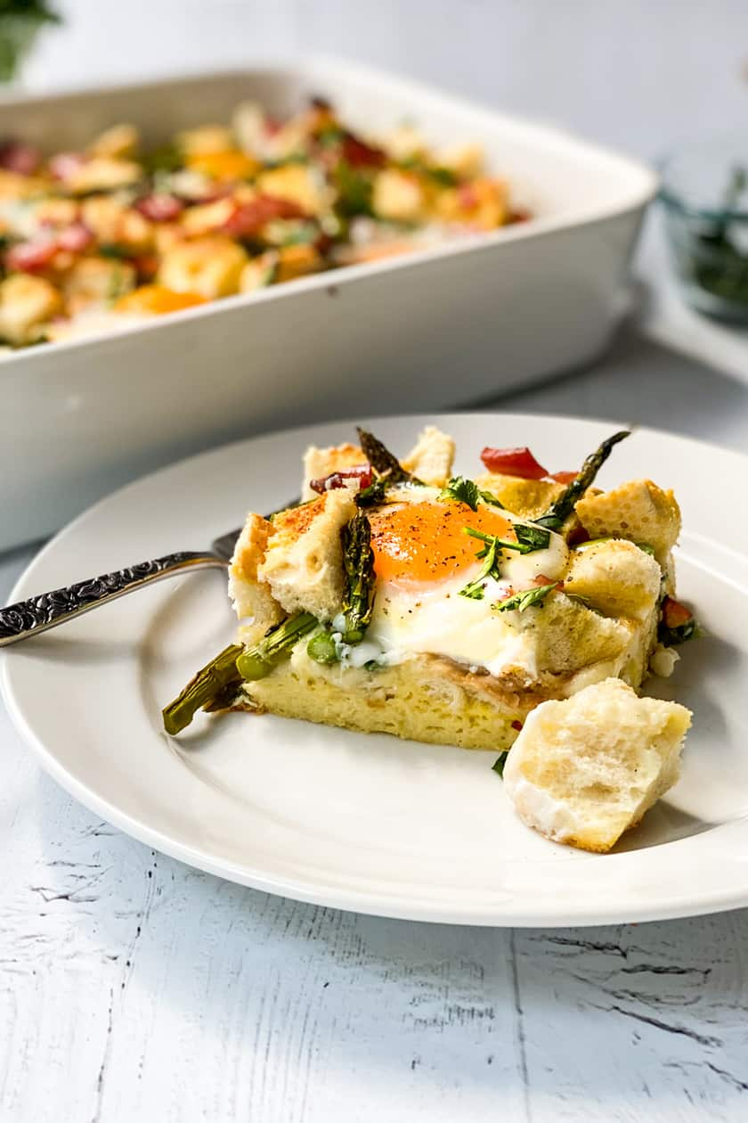 Square of Ham and Asparagus Strata on a White Plate
