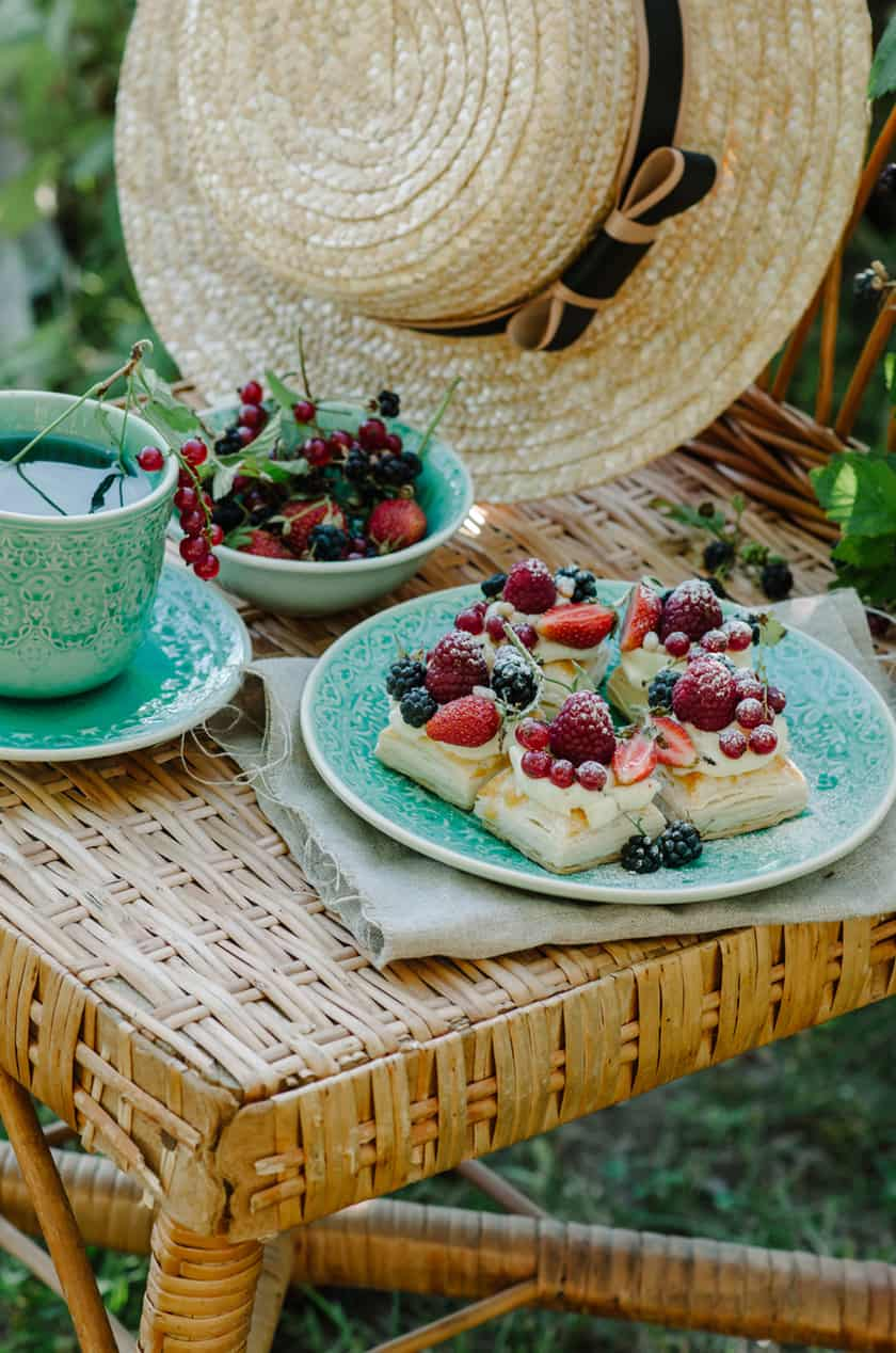 Berry Puff Pastry Tarts on a Wicker Chair