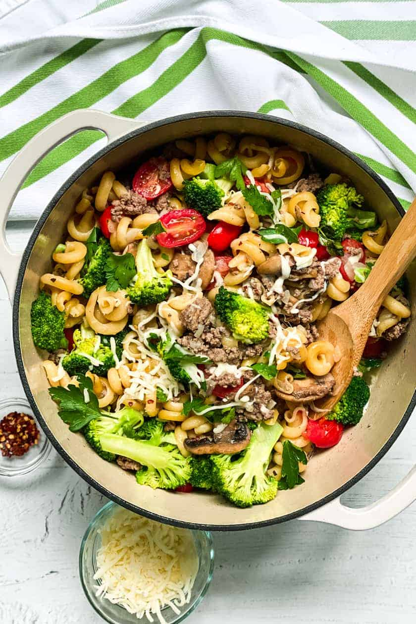 Top view of Easy One Pot Pasta with Ground Beef and Broccoli with a Wooden Spoon