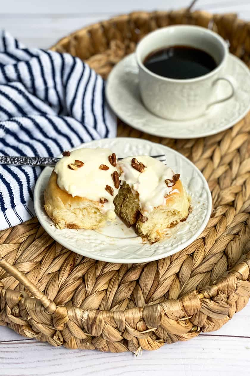 Homemade Cinnamon Roll on a Wicker Tray with Coffee