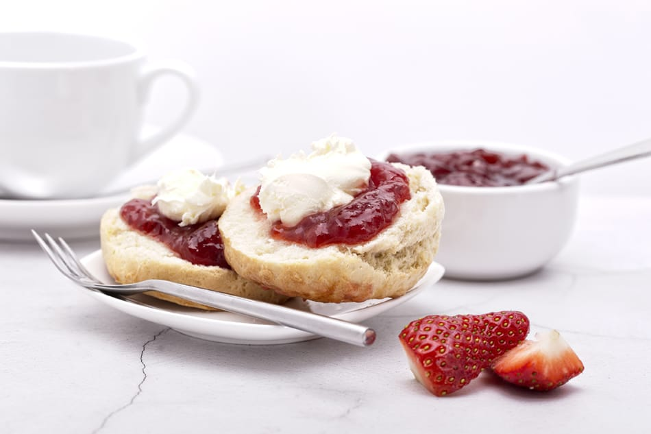 Clotted Cream with Strawberry Jam on a Homemade Scone