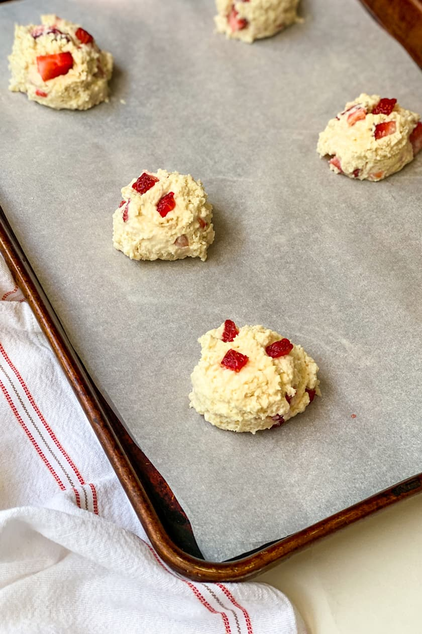 Unbaked Mounds of Fresh Strawberry Scones Dough on a Baking Sheet