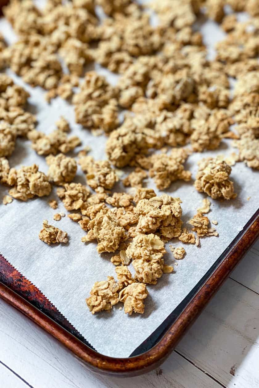 Baked Peanut Butter Granola Clusters on a Baking Sheet