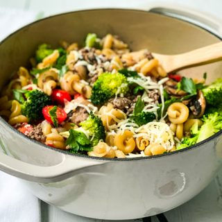 Easy One Pot Pasta with Ground Beef and Broccoli in a White Dutch Oven