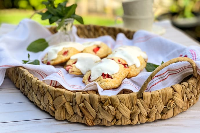 Fresh Strawberry Scones in a Basket Outdoors with Tea