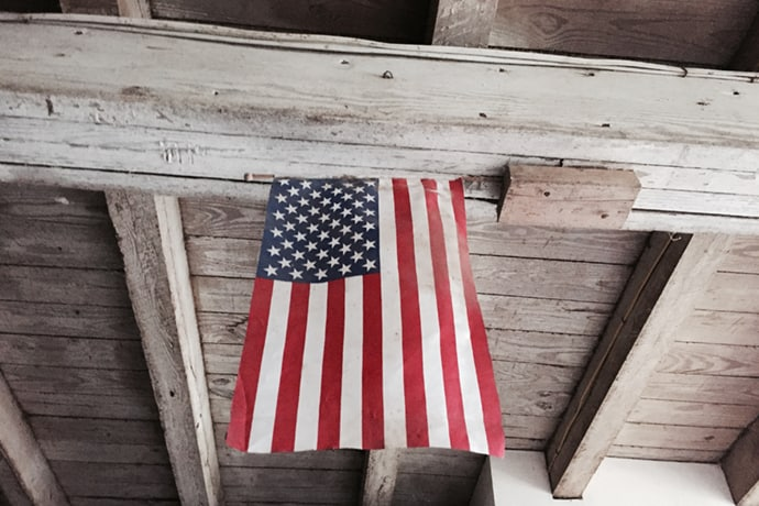 Memorial Day Flag Hanging in a Barn