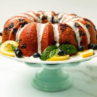 Sweet Tea Lemon Blueberry Yogurt Cake on a Teal Cake Stand