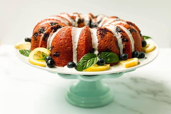 Sweet Tea Lemon Blueberry Yogurt Cake on a Teal Cake Stand