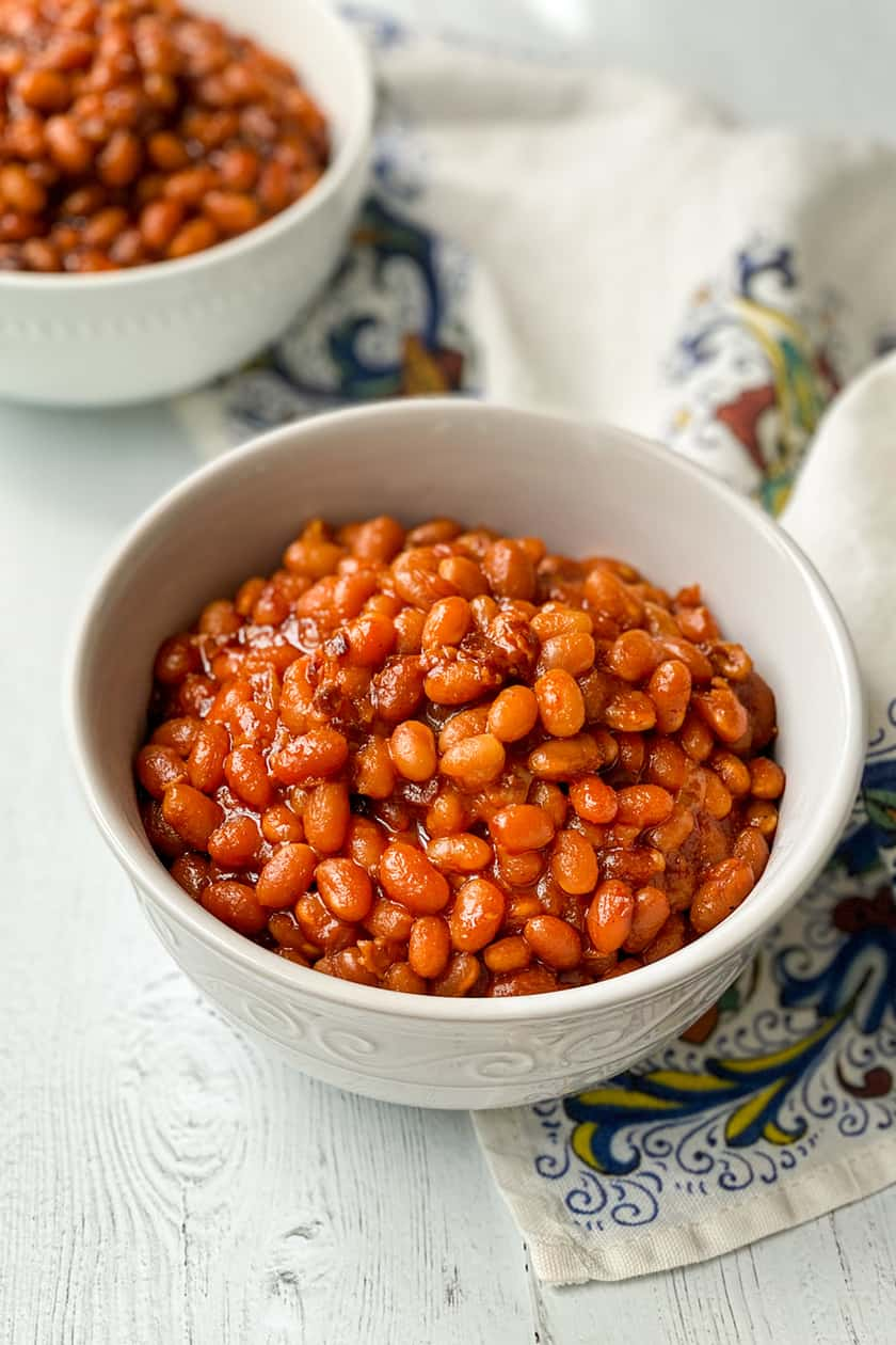 Cooked Instant Pot Baked Beans in a white bowl