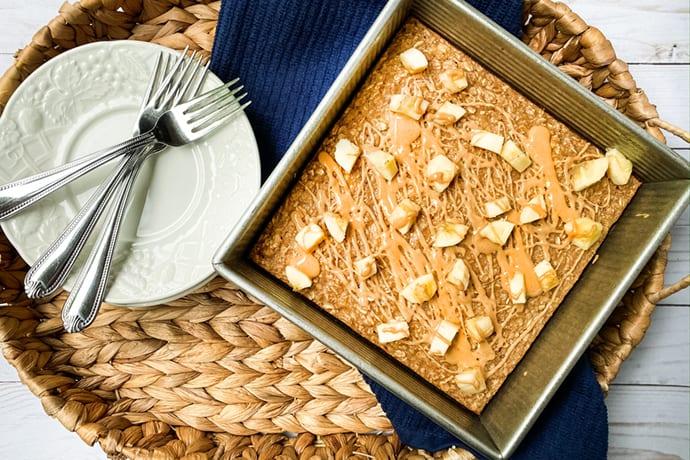 Baked Peanut Butter Banana Oatmeal on a Wicker Tray