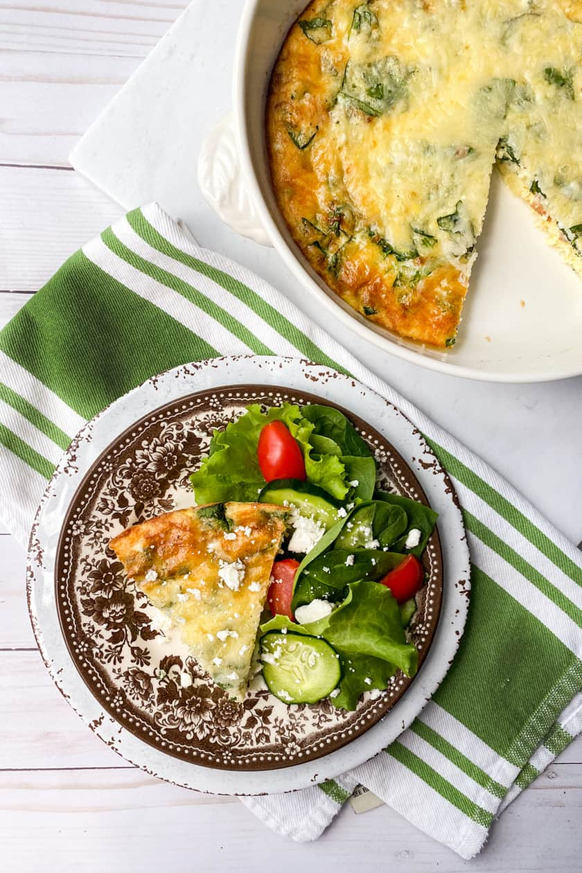 Top view of sliced Easy Crustless Quiche with Bacon, Cheese and Spinach