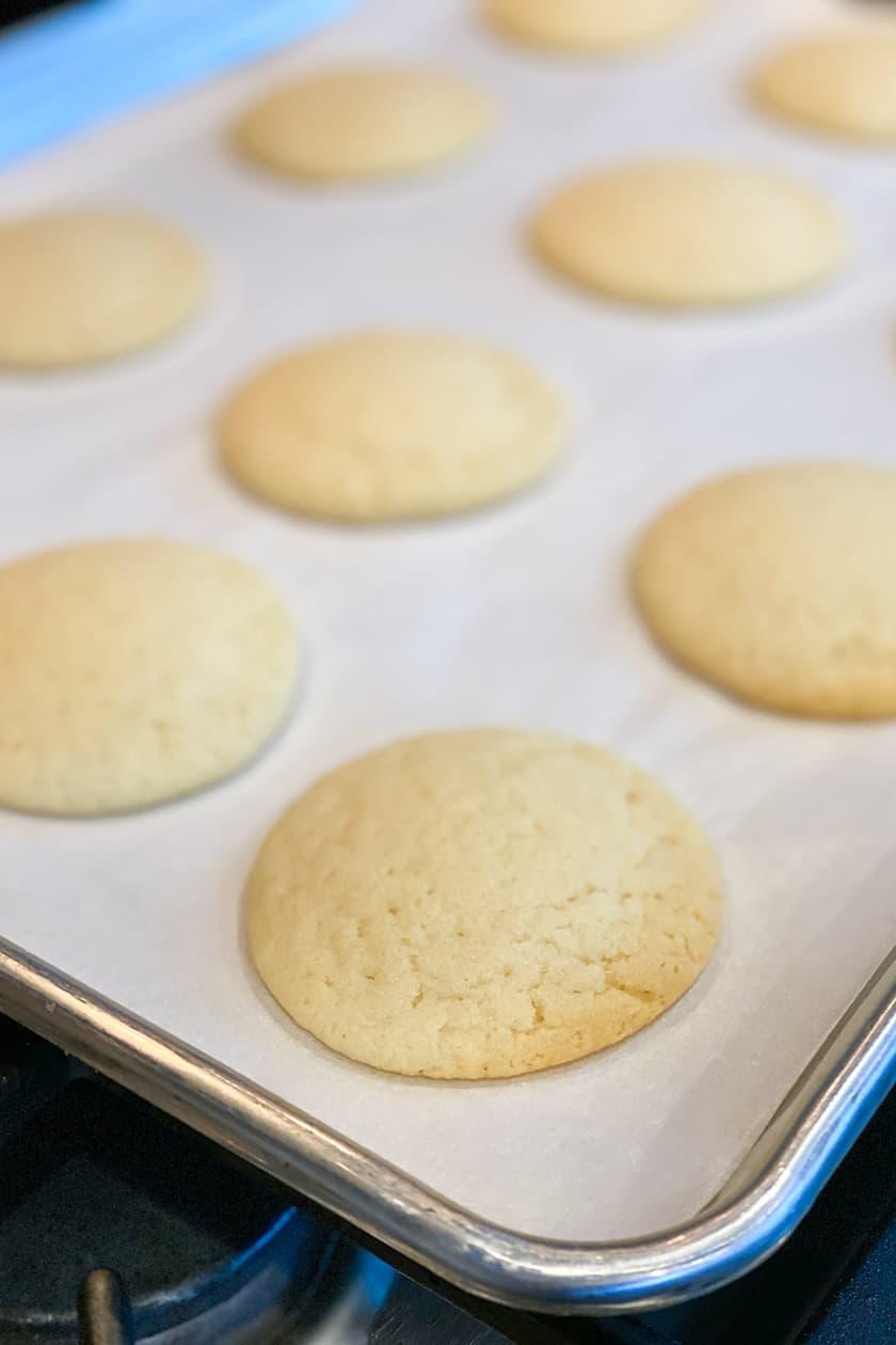 Baked Vanilla Tea Cakes on a Baking Sheet