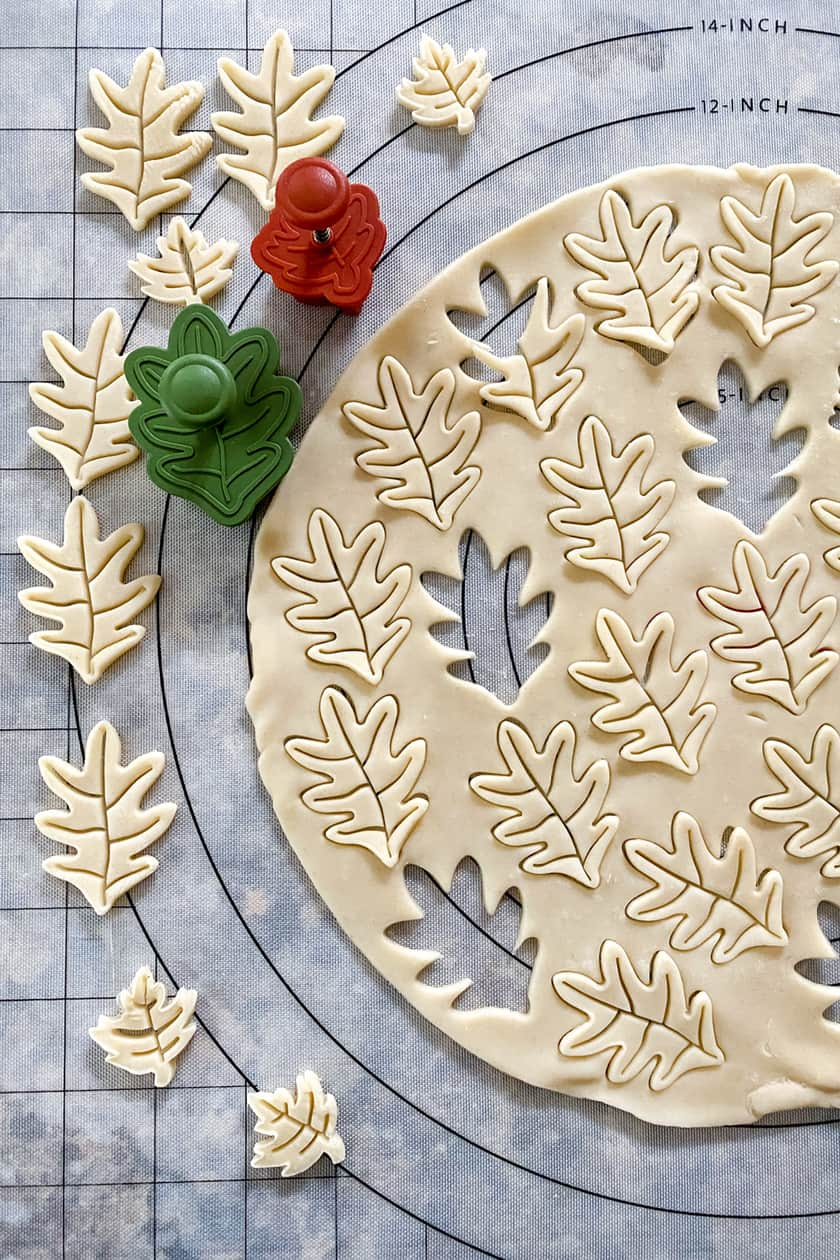 Unbaked pastry cut into fall leaves with cutters