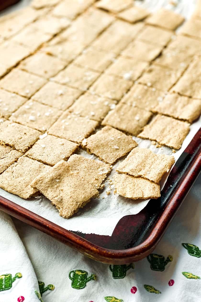 Baked crispy homemade crackers on a baking sheet