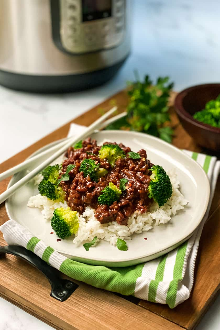 Plate of Instant Pot Beef and Broccoli with Chopsticks