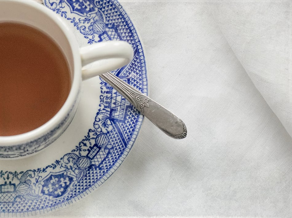 Blue and white teacup with tea.