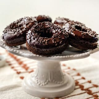 Double Chocolate Baked Donuts on a White Pedistal