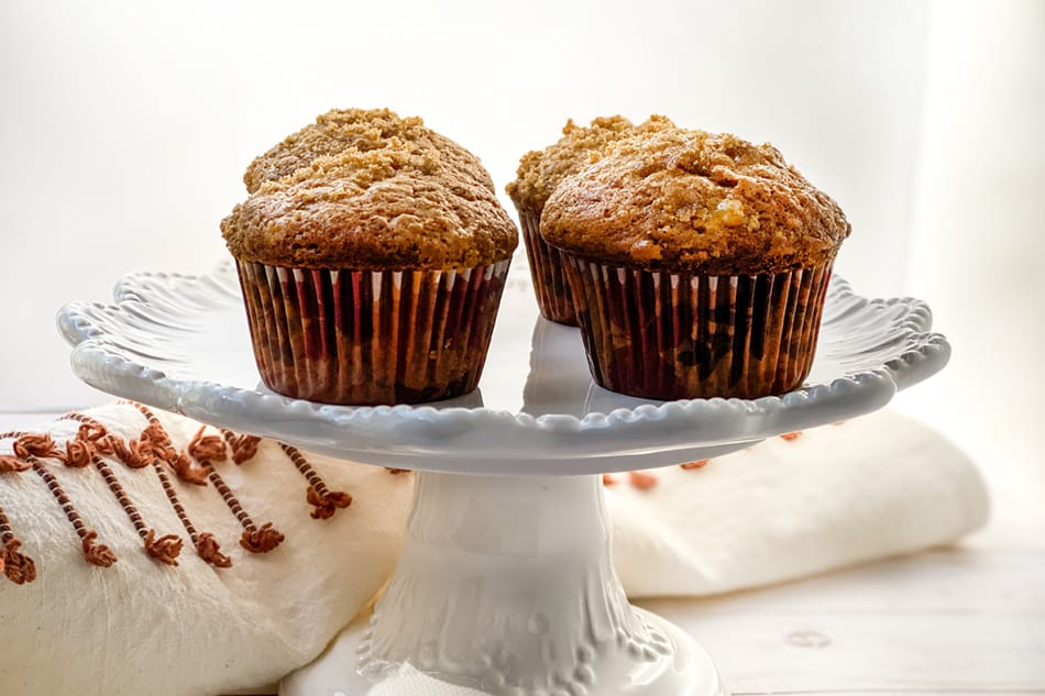 Side view of Maple Banana Muffins on a Cake Plate