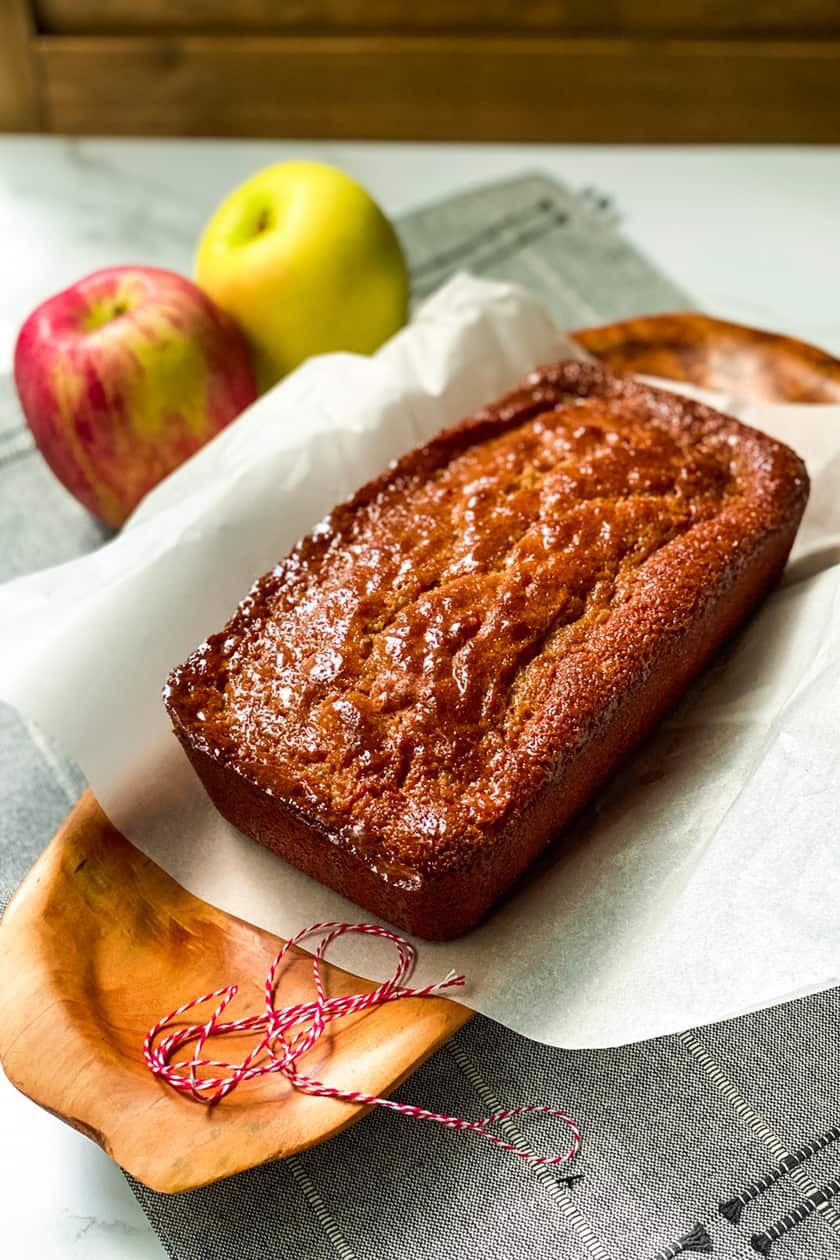 Apple Spice Visiting Cake with Parchment and Red Apples