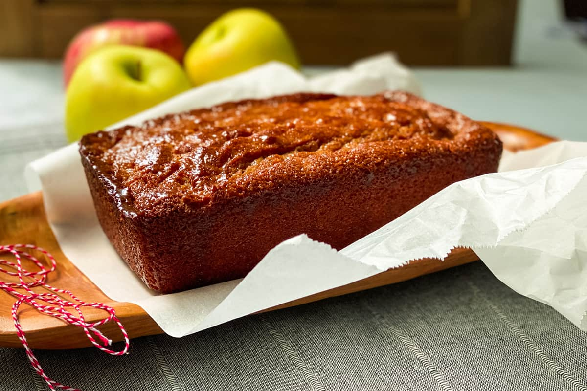 Apple Spice Visiting Cake on a Sheet of Parchment Paper with Twine