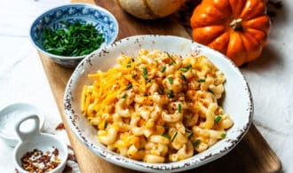 Instant Pot Butternut Squash Mac and Cheese on a Wooden Board with Pumpkins