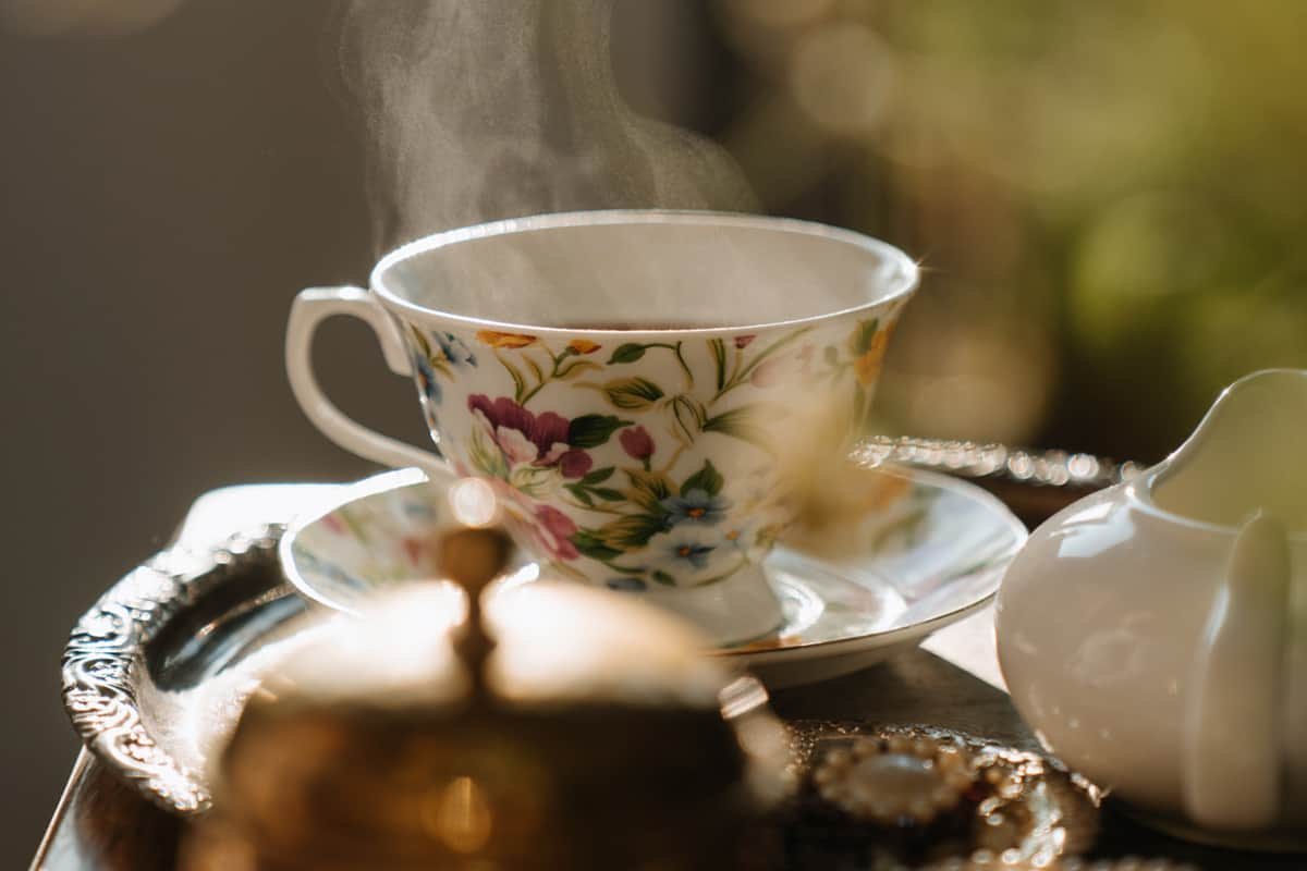 closeup view of a steaming cup of herbal tea