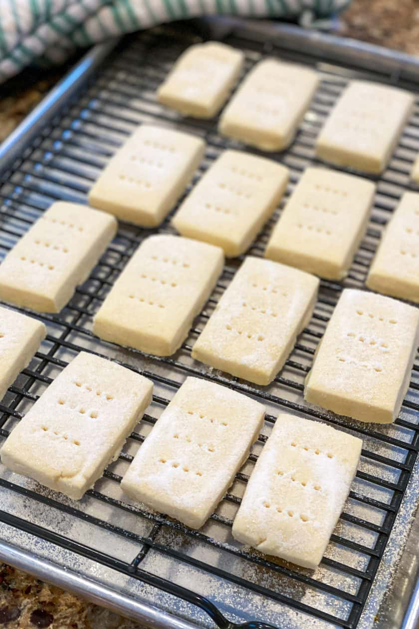Baked shortbread cookies on a cooling rack