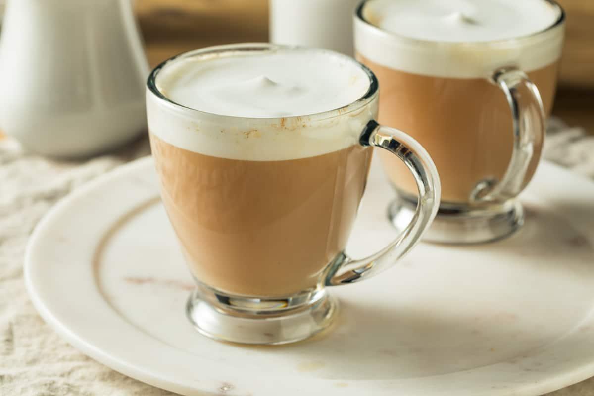 Two London Fog Tea Lattes on a White Plate