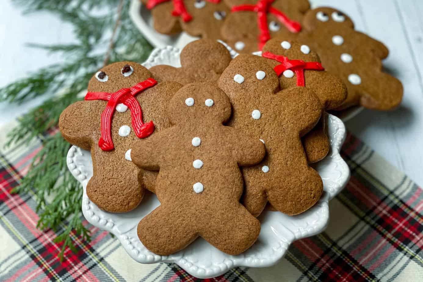 Decorated Gingerbread Cookies on a White Stand