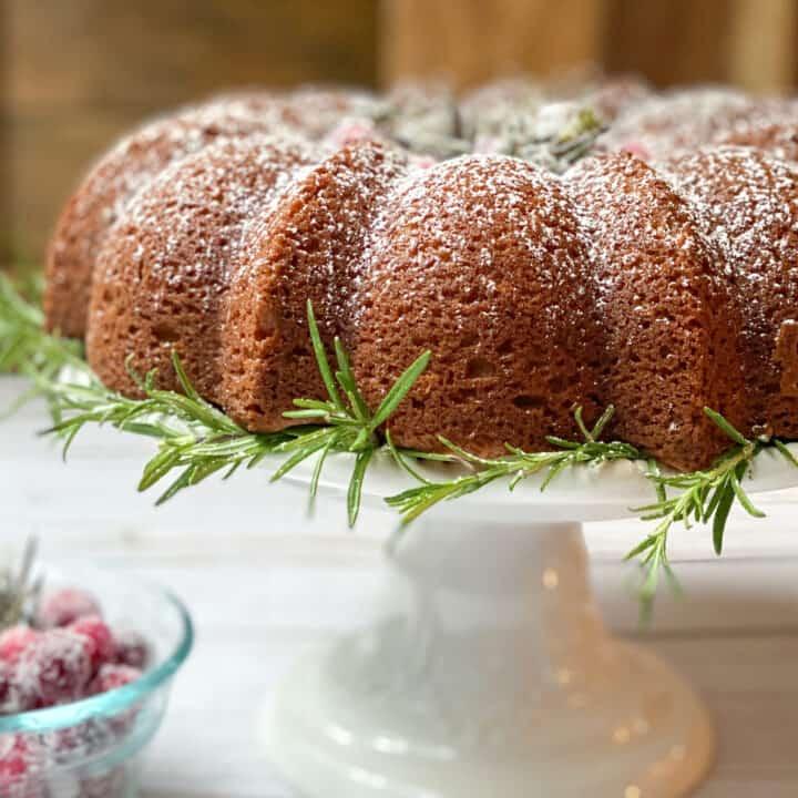 Spiced Christmas Cake on a White Pedestal