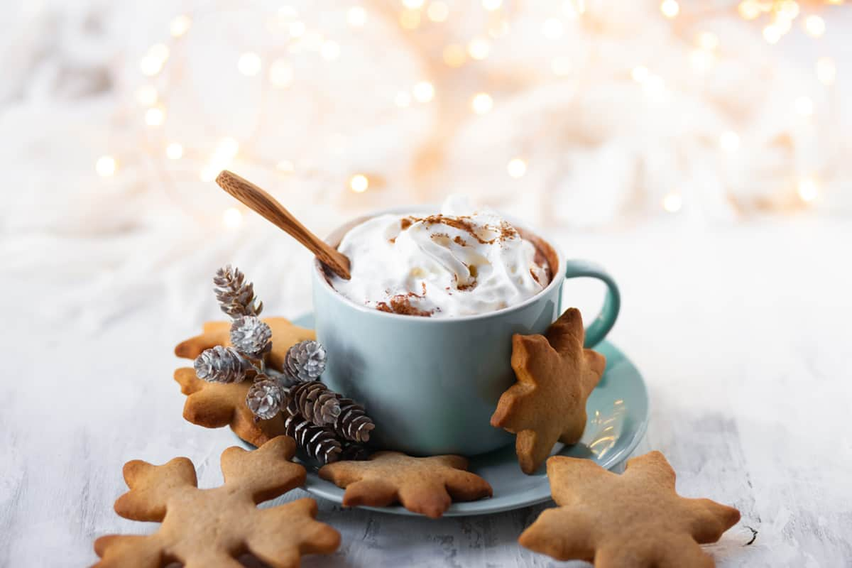 Top view of Gingerbread Latte in a Blue Mug with Gingerbread Cookies