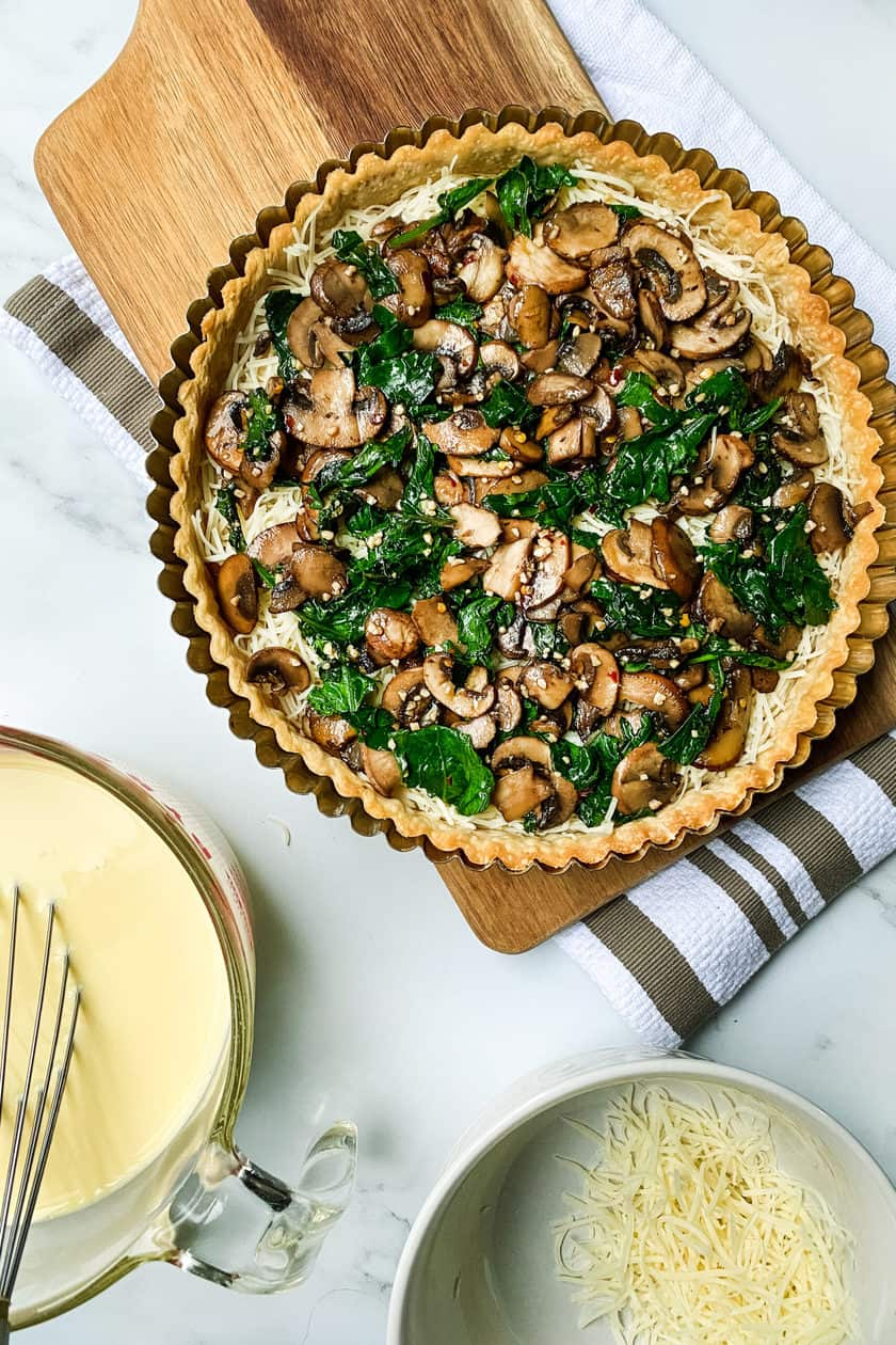 Layers of unbaked Easy Mushroom and Kale Quiche