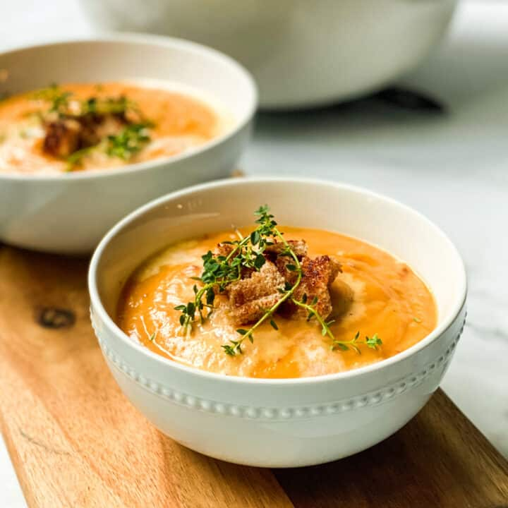 2 servings of Easy Creamy Root Vegetable Soup in white bowls
