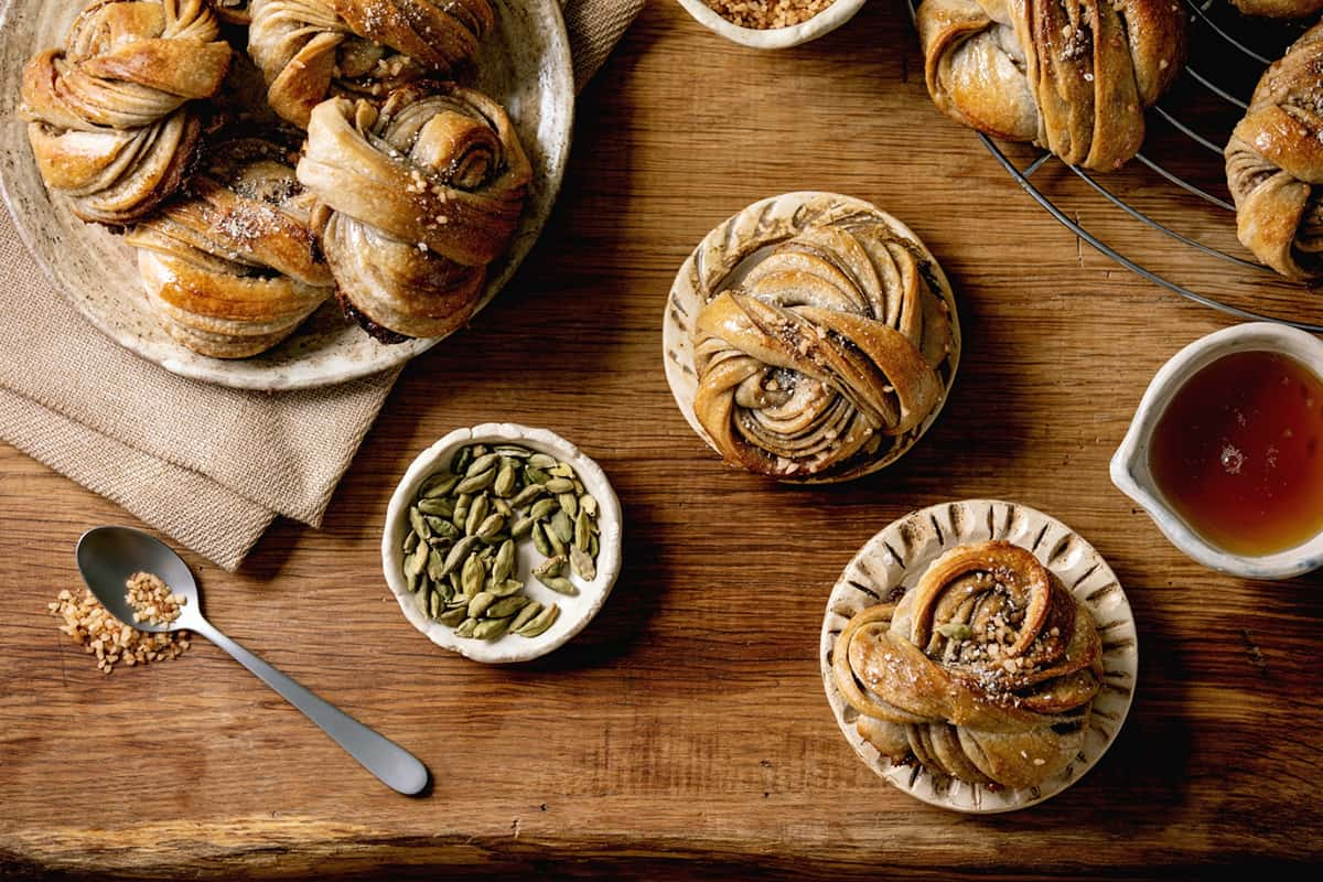 Cinnamon Buns on a Wood Table for Fika: A Swedish Coffee Ritual that Feeds the Soul