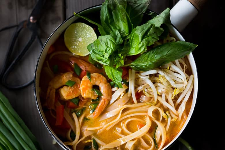 Thai Coconut Noodle Soup in a Black Bowl with Basil for Healthy 20 Minute Dinners