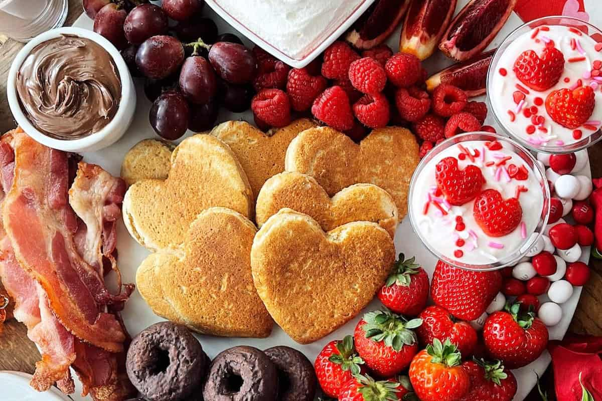 Valentine Breakfast Board with pancakes and berries for 20 Easy Valentine's Day Breakfast Recipes