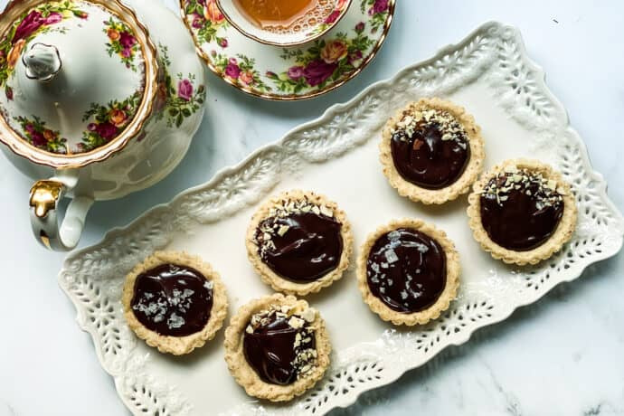 Chocolate Ganache Mini Tarts on a White Tea Platter