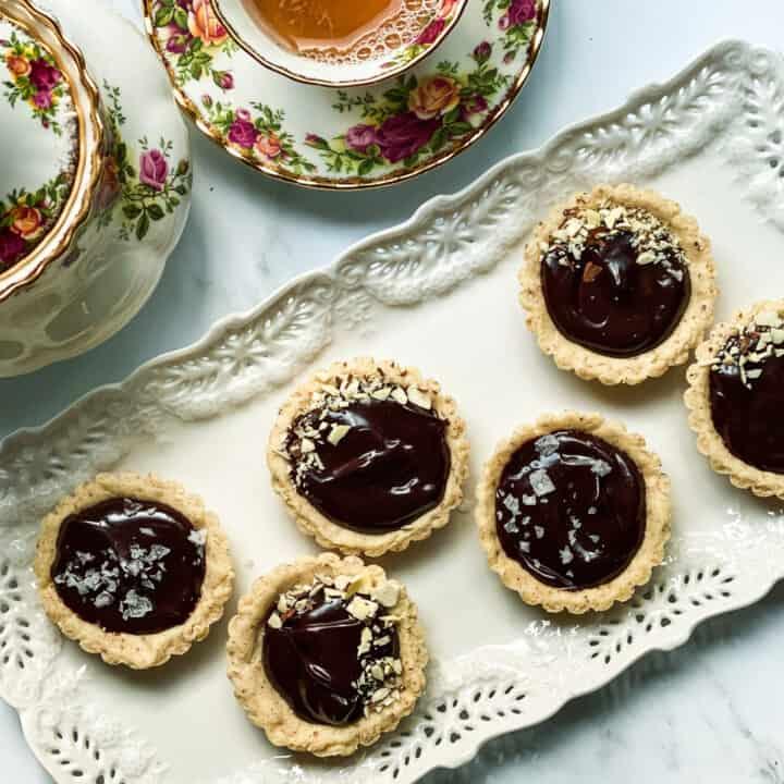 Chocolate Ganache Mini Tarts on a White Tea Platter