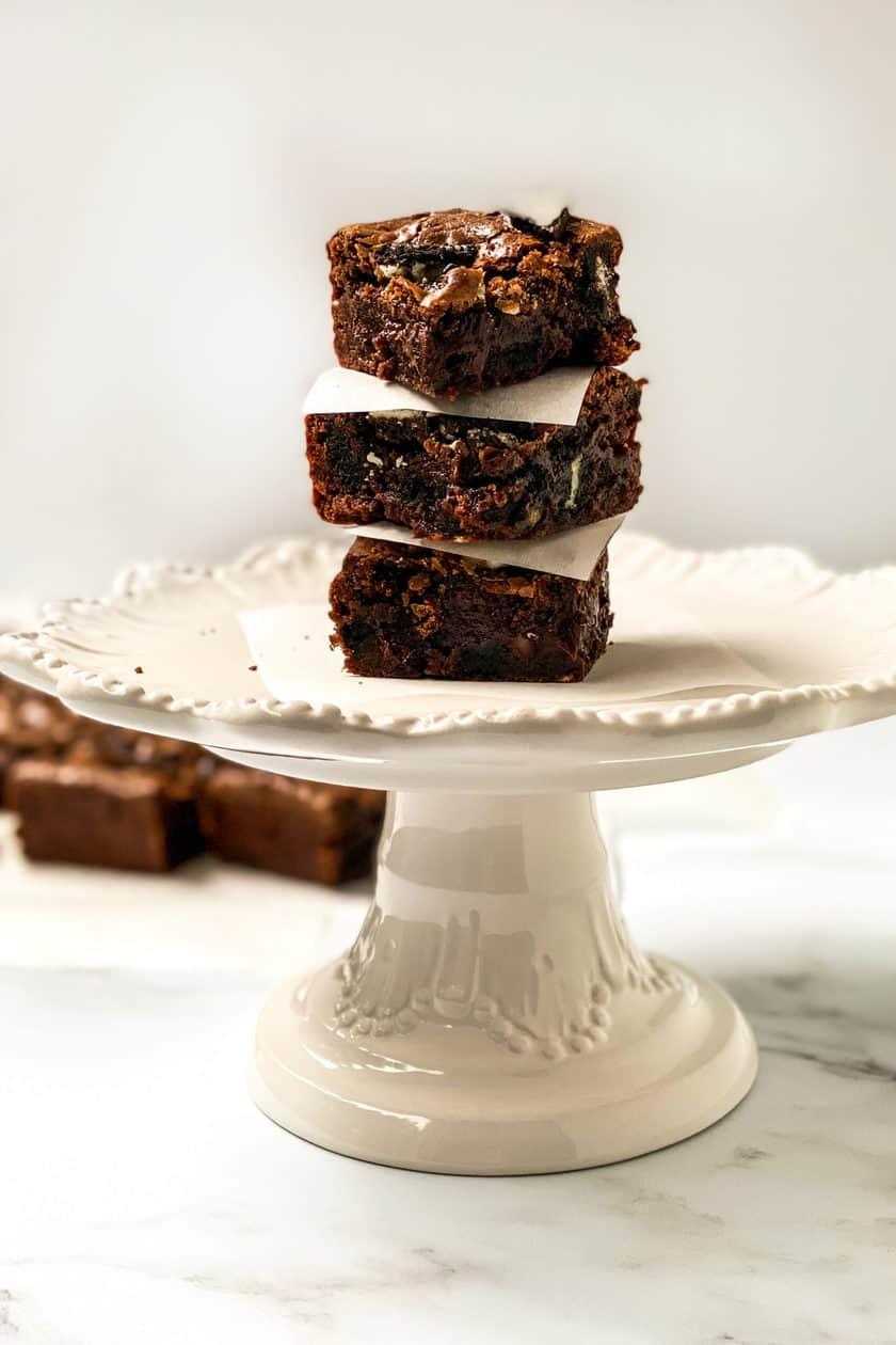 3 Brownie Squares on a White Cake Pedestal