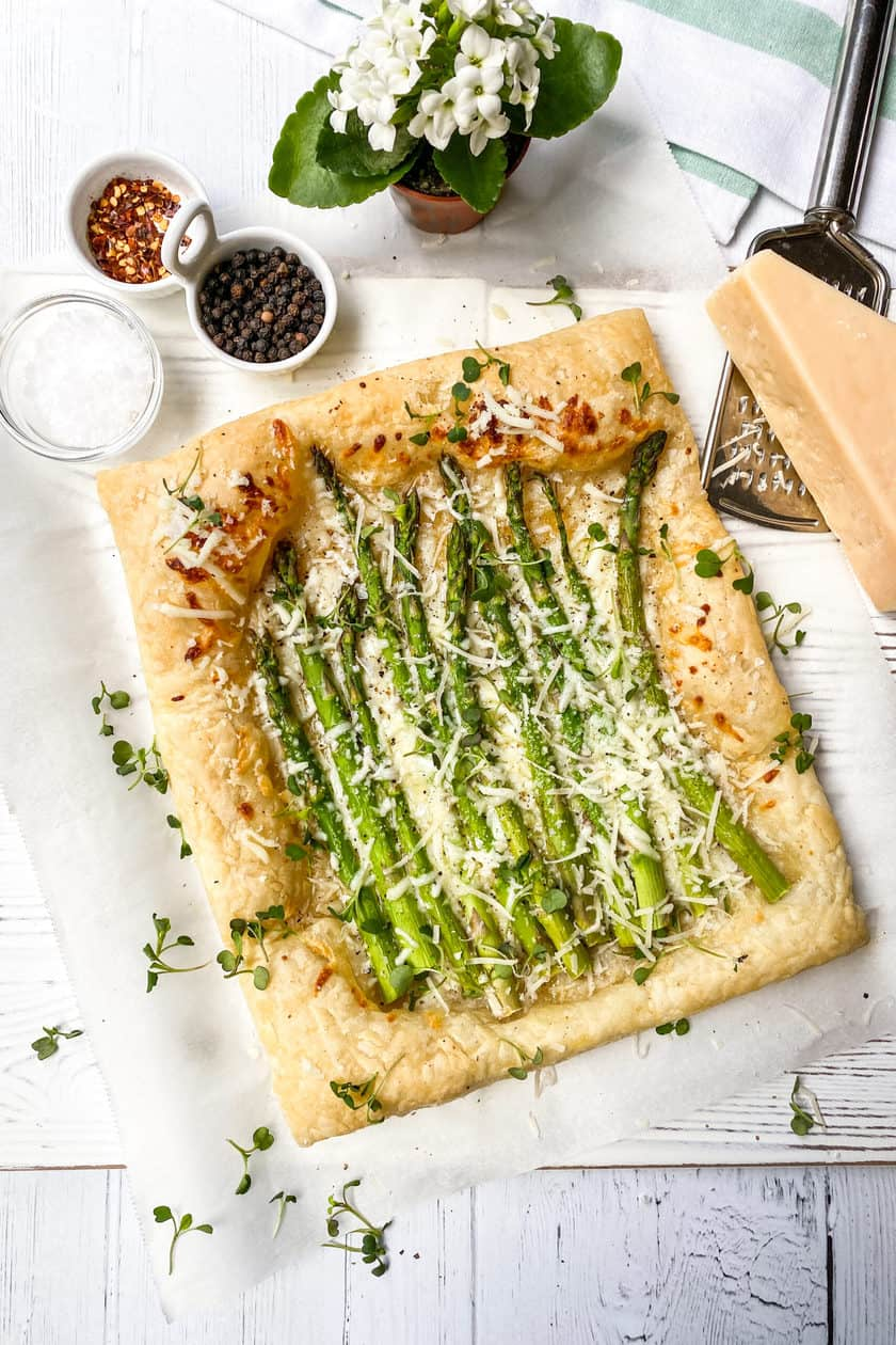 Asparagus Tart being garnished with microgreens