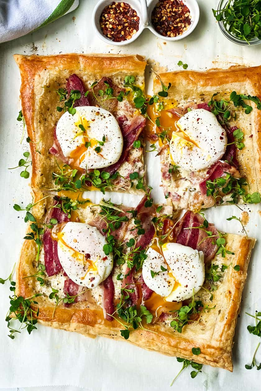 Quartered Breakfast Tart with bacon and eggs.