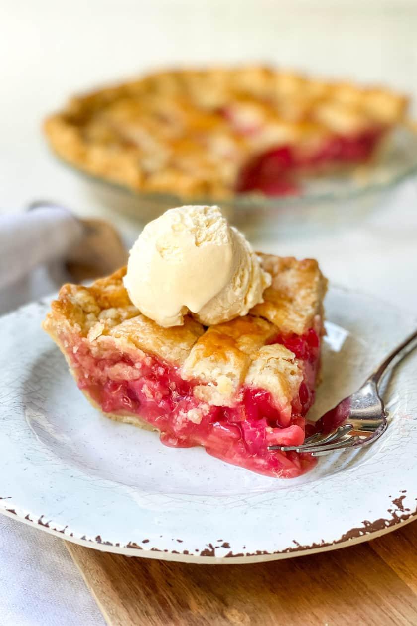 Slice of Rhubarb Pie on a Plate with Vanilla Ice Cream