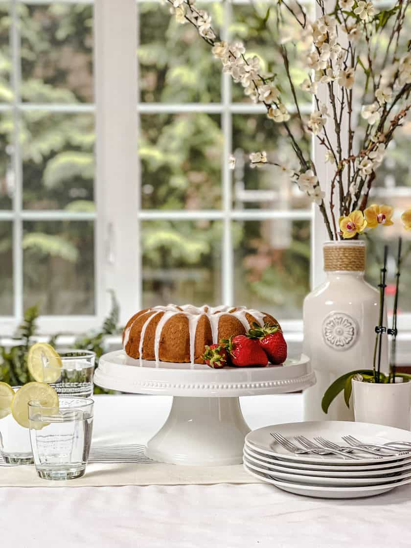 Wide view of Strawberry Bundt Cake in front of windows