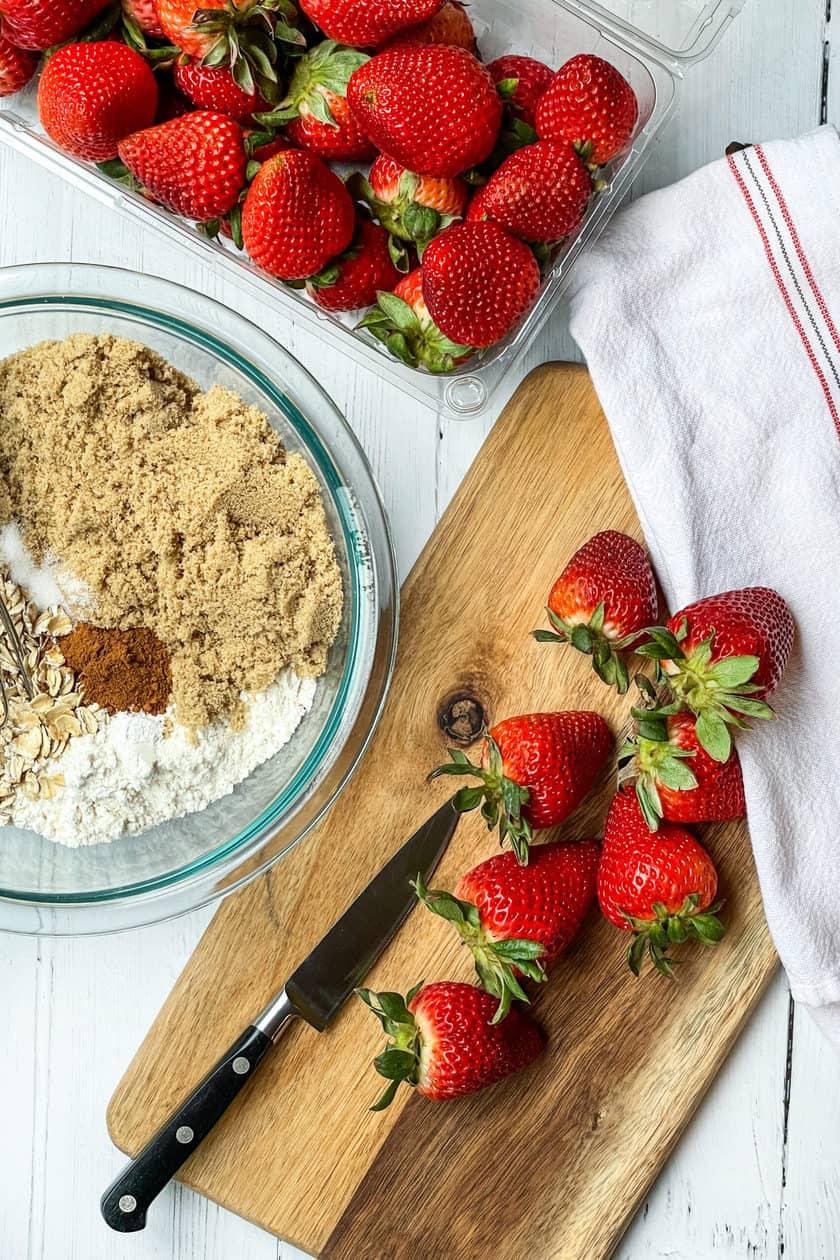 Strawberry Crisp ingredients on a wooden sandwich board