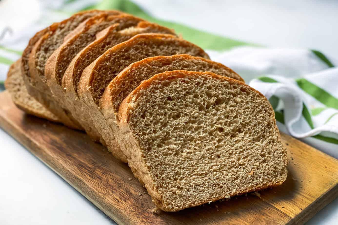 Sliced Homemade 100% Whole Wheat Bread on a Bread Board
