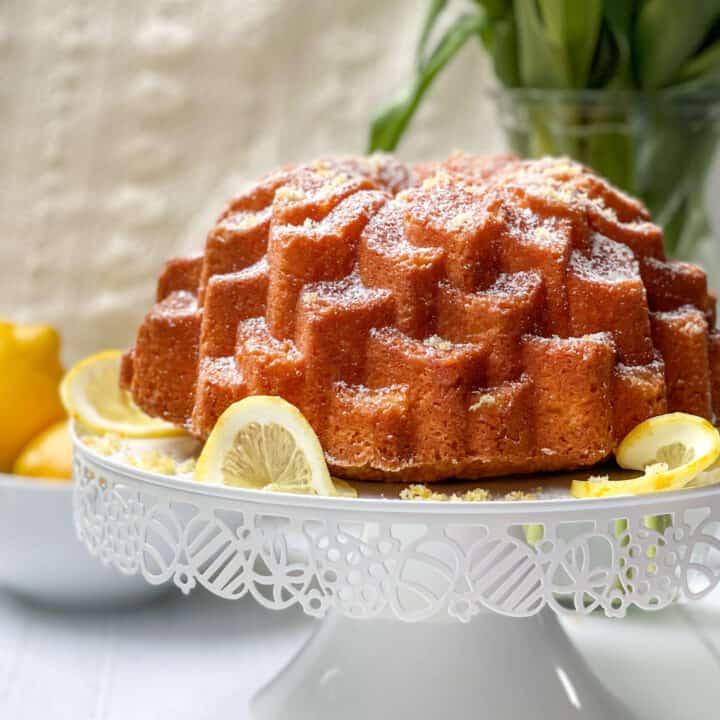 Side view of Lemon Pound Cake on a White Cake Stand