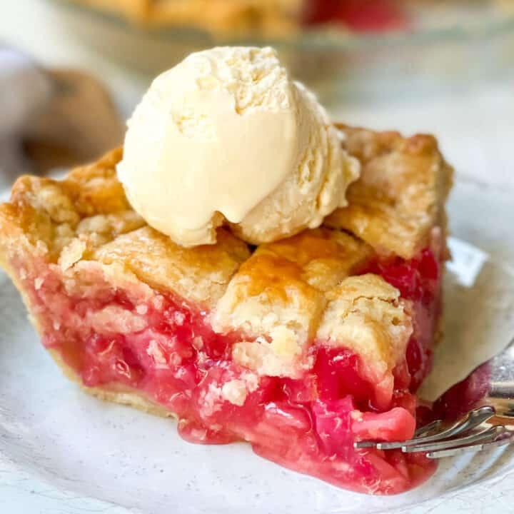 Slice of Rhubarb Pie with Vanilla Ice Cream on top.
