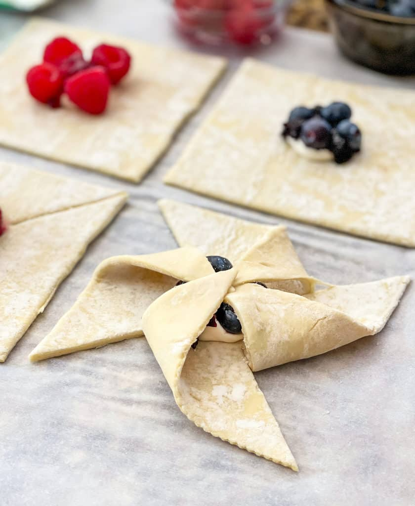 Unbaked puff pastry in pinwheel shape