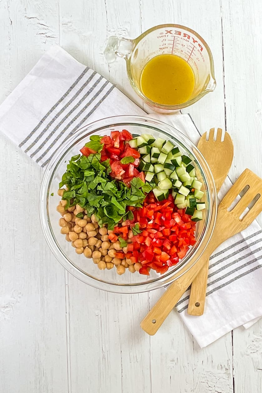 Quinoa Salad ingredients with lemon dressing on the side